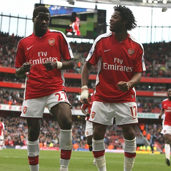 Emmanuel Eboue celebrates scoring the 4th Arsenal goal with Alex Song